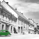 A green car on a black and white photo